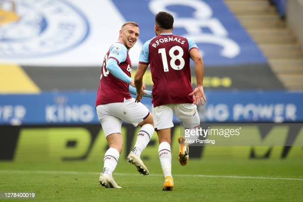Pablo Fornals of West Ham celebrates with teammate Jarrod Bowen after scoring his sides second goal during the Premier League match between Leicester...