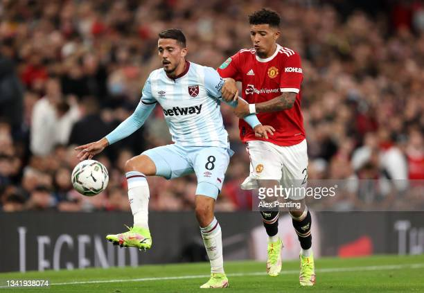 Pablo Fornals of West Ham United battles for possession with Jadon Sancho of Manchester United during the Carabao Cup Third Round match between...