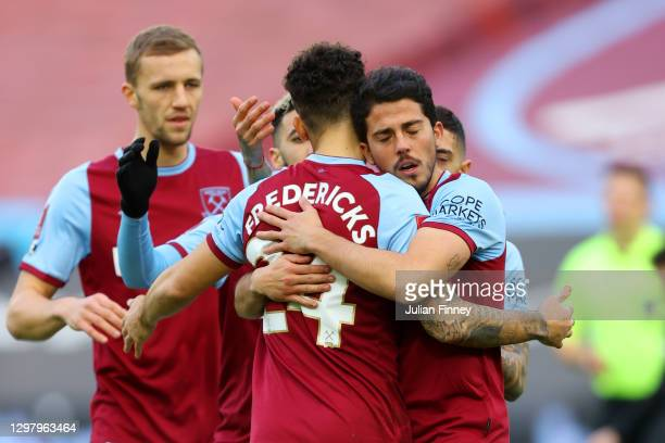 Pablo Fornals of West Ham United celebrates with teammate Ryan Fredericks after scoring their team's first goal during The Emirates FA Cup Fourth...