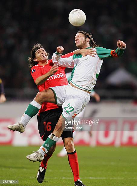 Pablo Garcia of Vigo and Torsten Frngs of Bremen fight for the ball during the UEFA Cup round of 16, second leg match between Werder Bremen and Celta...