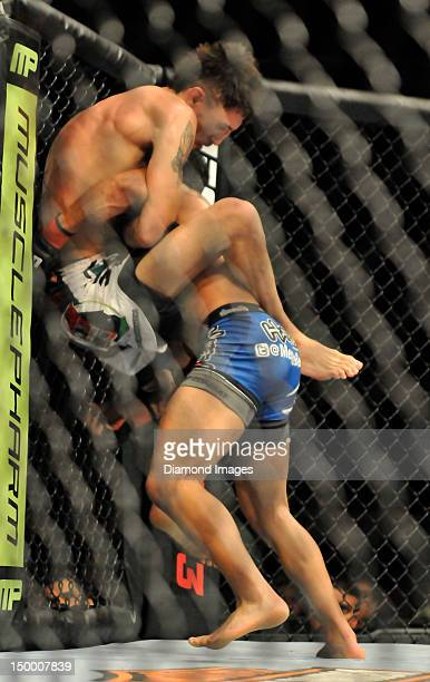 Pablo Garza supports himself on the cage while Dennis Bermudez goes for the takedown during a featherweight bout during UFC on FOX 3 at Izod Center...