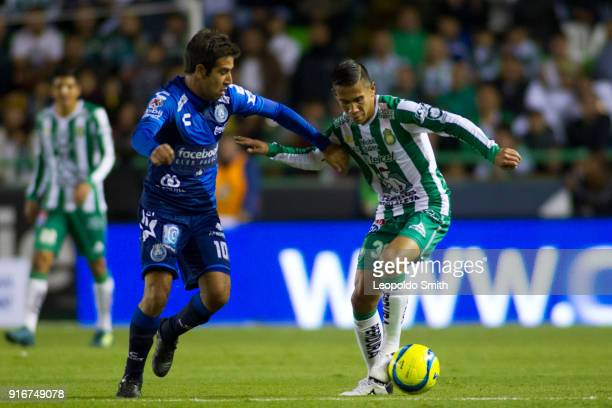 Pablo Gonzalez of Puebla figths for the ball with Jose Rodriguez of Leon during the 6th round match between Leon and Puebla as part of the Torneo...