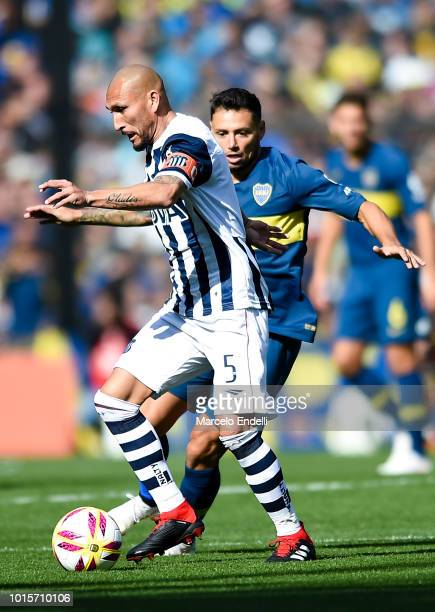 Pablo Guinazu of Talleres fights for the ball with Mauro Zarate of Boca Juniors during a match between Boca Juniors and Talleres as part of Superliga...