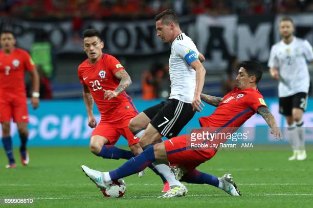 Pablo Hernandez of Chile challenges Julian Draxler of Germany during the FIFA Confederations Cup Russia 2017 Group B match between Germany and Chile...