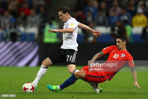 Pablo Hernandez of Chile fouls Sebastian Rudy of Germany during the FIFA Confederations Cup Russia 2017 Group B match between Germany and Chile at...