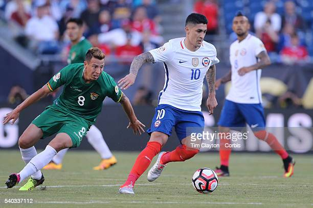 Pablo Hernandez of Chile is challenged by Martin SmedbergDalence of Bolivia during the Chile Vs Bolivia Group D match of the Copa America Centenario...