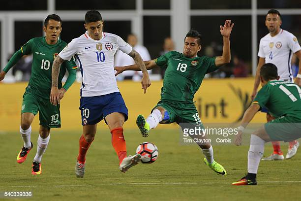Pablo Hernandez of Chile is challenged by Rodrigo Ramallo of Bolivia during the Chile Vs Bolivia Group D match of the Copa America Centenario USA...
