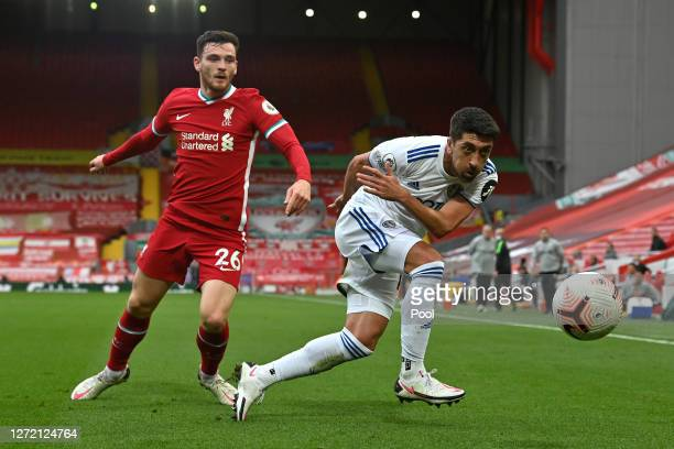 Pablo Hernandez of Leeds United is challenged by Andrew Robertson of Liverpool during the Premier League match between Liverpool and Leeds United at...