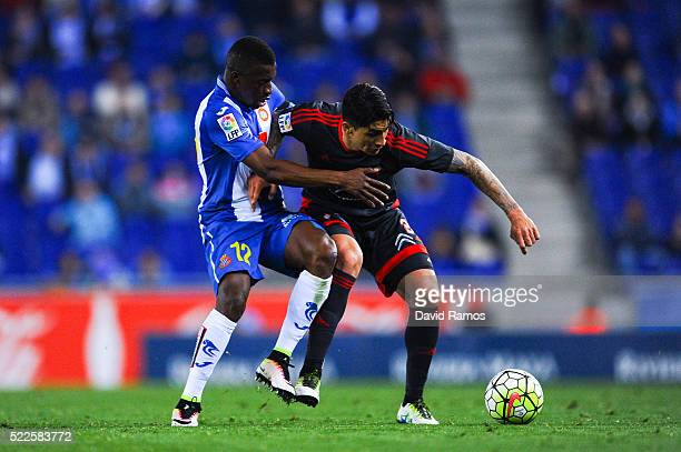 Pablo Hernandez of RC Celta de Vigo competes for the ball with Pape Diop of RCD Espanyol during the La Liga match between Real CD Espanyol and Celta...
