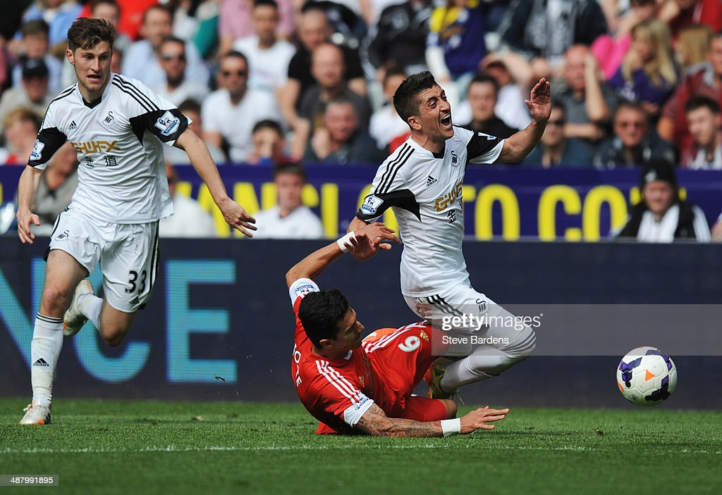 Pablo Hernandez of Swansea City is tackled by Jose Fonte of Southampton during the Barclays Premier League match between Swansea City and Southampton at Liberty Stadium on May 3, 2014 in Swansea, Wales.