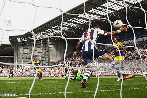 Pablo Hernandez of Swansea scores their second goal past Liam Ridgewell of West Brom during the Barclays Premier League match between West Bromwich...