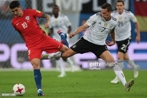 Pablo Hernandez of the Chile national football team and Julian Draxler of the Germanyl national football team vie for the ball during the 2017 FIFA...