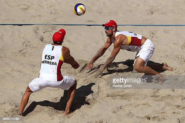 Pablo Herrera Allepuz of Spain and teammate Adrian Gavira Collado watch the ball during a Men's Round of 16 match between Spain and Brazil on Day 8...