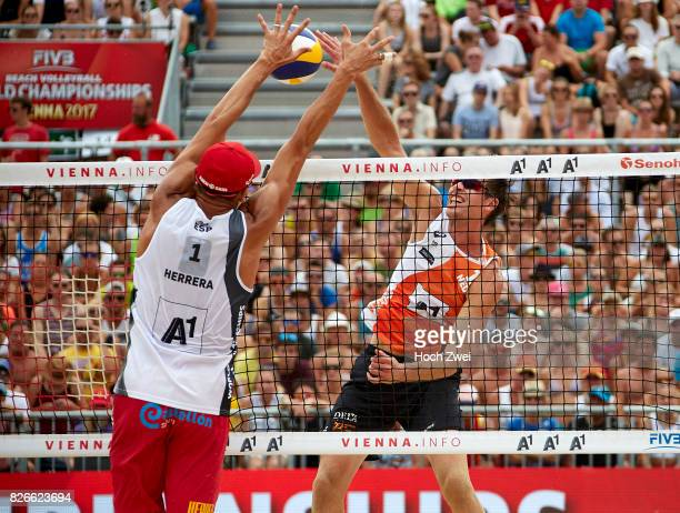 Pablo Herrera Allepuz of Spain competes against Maarten Van Garderen of Netherlands during Day 9 of the FIVB Beach Volleyball World Championships...