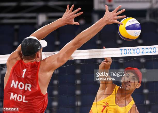 Pablo Herrera Allepuz of Team Spain competes against Anders Berntsen Mol of Team Norway during the Men's Preliminary - Pool A beach volleyball on day...