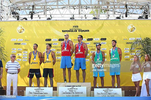 Pablo Herrera and Adrian Gavira of Spain Phil Dalhausser and Sean Rosenthal of USA and Paolo Nicolai and Daniele Lupo of Italy pose for the award...