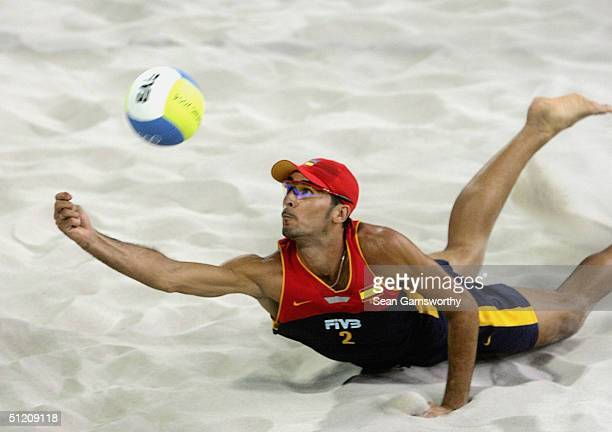 Pablo Herrera for Spain digs the ball during the men's semifinal match Between Australia and Spain on August 23, 2004 during the Athens 2004 Summer...
