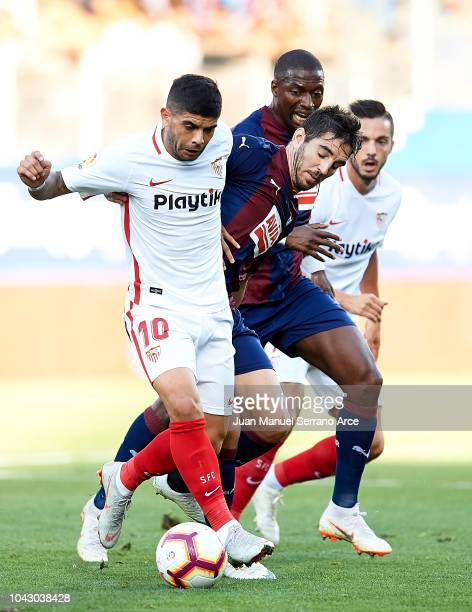 Pablo Hervias of SD Eibar duels for the ball with Ever Banega of Sevilla FC during the La Liga match between SD Eibar and Sevilla FC at Ipurua...