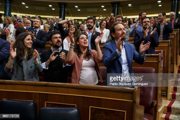 Pablo Iglesias Irene Montero and other members of Podemos party celebrate the result of the noconfidence motion at the Lower House of the Spanish...