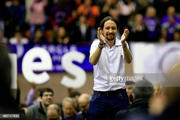 Pablo Iglesias, secretary general of the Podemos party, applaudes as he finishes speaking at a party conference in Barcelona, Spain on Sunday, Dec....