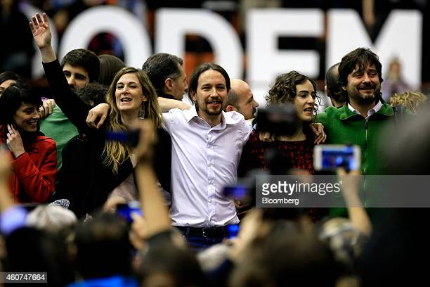 Pablo Iglesias, secretary general of the Podemos party, center, poses with fellow party members at a party conference in Barcelona, Spain on Sunday,...