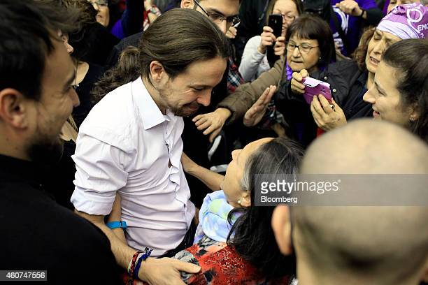 Pablo Iglesias, secretary general of the Podemos party, embraces a supporter as he arrives to speak at a party conference in Barcelona, Spain on...