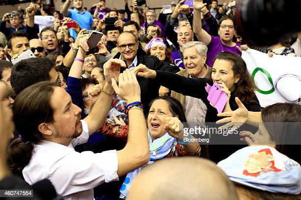 Pablo Iglesias, secretary general of the Podemos party, greets his supporters as he arrives to speak at a party conference in Barcelona, Spain on...