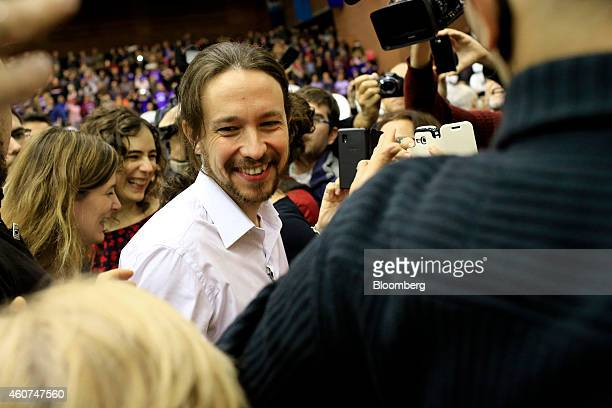 Pablo Iglesias, secretary general of the Podemos party, smiles as he arrives to speak at a party conference in Barcelona, Spain on Sunday, Dec. 21,...