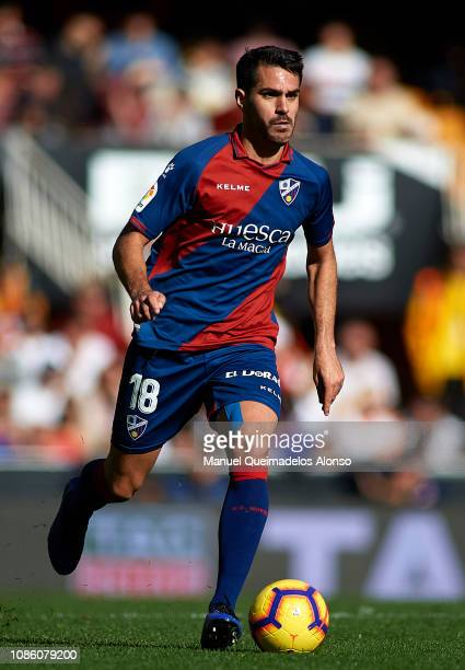 Pablo Insua of Huesca runs with the ball during the La Liga match between Valencia CF and SD Huesca at Estadio Mestalla on December 23 2018 in...