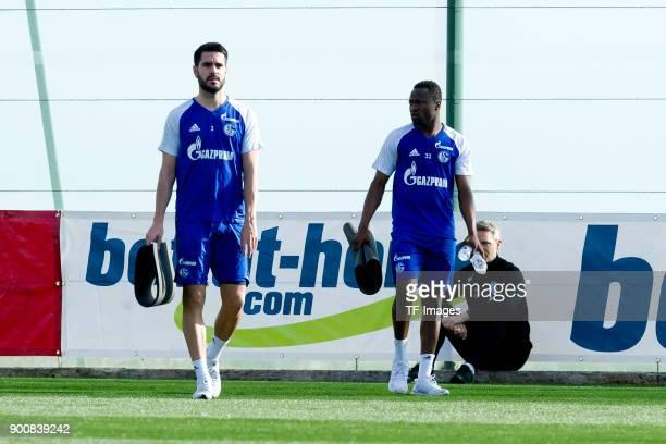 Pablo Insua of Schalke and Bernard Tekpetey of Schalke walk during the FC Schalke 04 training camp at Hotel Melia Villaitana on January 03 2018 in...