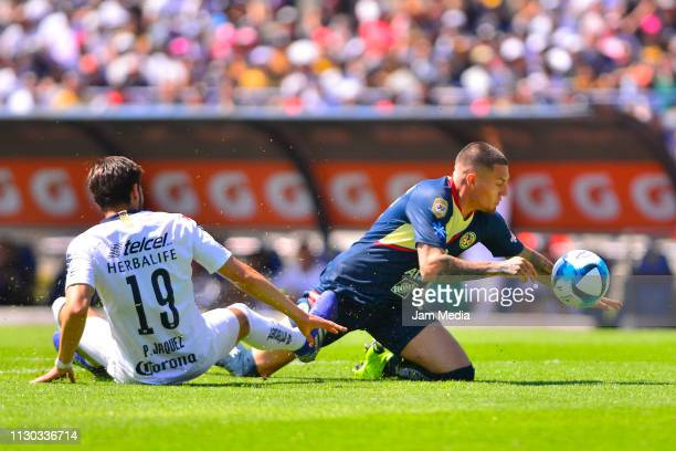 Pablo Jaques of Pumas struggles for the ball against Nicolas Castillo of America during the seventh round match between Pumas UNAM and America as...