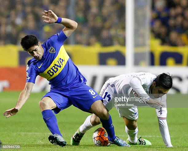 Pablo Javier Perez of Boca Juniors fights for the ball with Gonzalo Fabian Porras of Nacional during a second leg match between Boca Juniors and...