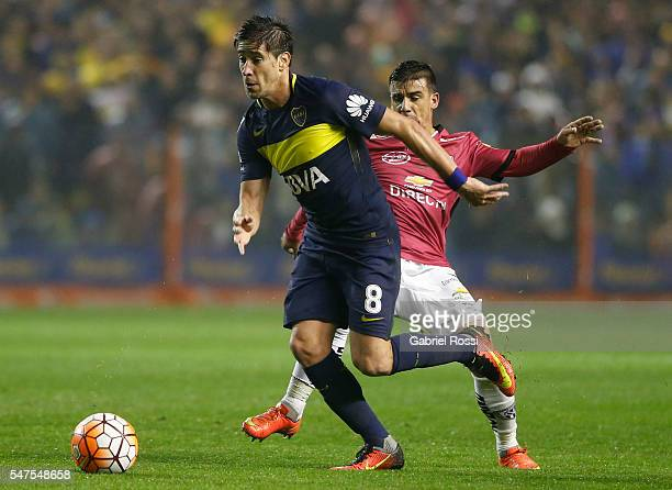 Pablo Javier Perez of Boca Juniors fights for the ball with Mario Rizotto of Independiente del Valle during a second leg match between Boca Juniors...