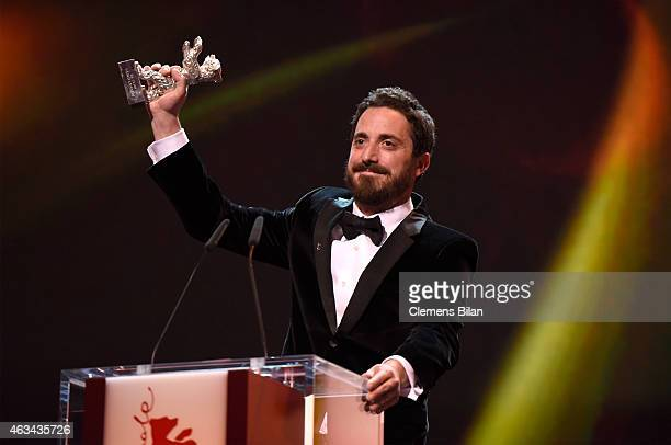Pablo Larrain accepts the silver bear Grand Jury Prize for 'The Club' on stage during the Closing Ceremony of the 65th Berlinale International Film...