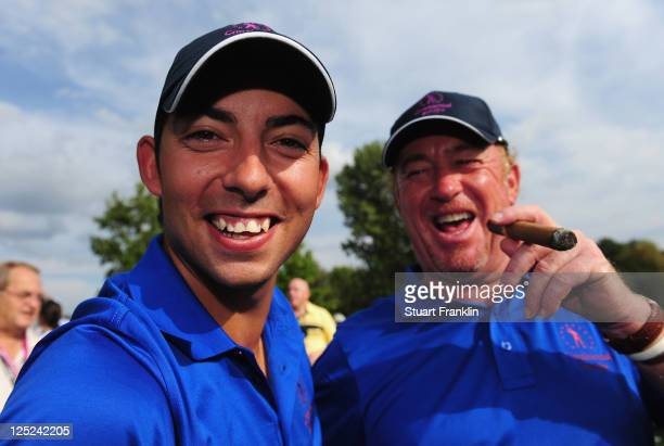 Pablo Larrazabal and Miguel Angel Jimenez of the Continental Europe team celebrate after winning their match during the second days fourball matches...