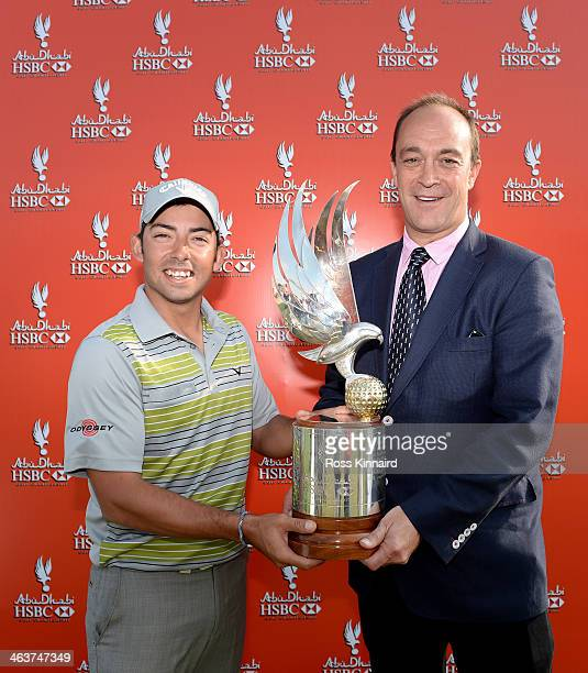 Pablo Larrazabal of Spain and Giles Morgan Global head of Sponsorship and Events HSBC Holdings Plc with the winners trophy after the final round of...