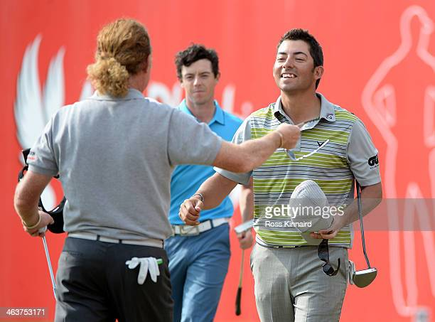 Pablo Larrazabal of Spain celebrates making a birdie four on the 18th hole to win the tournament with Miguel Angel Jimenez of Spain during the final...