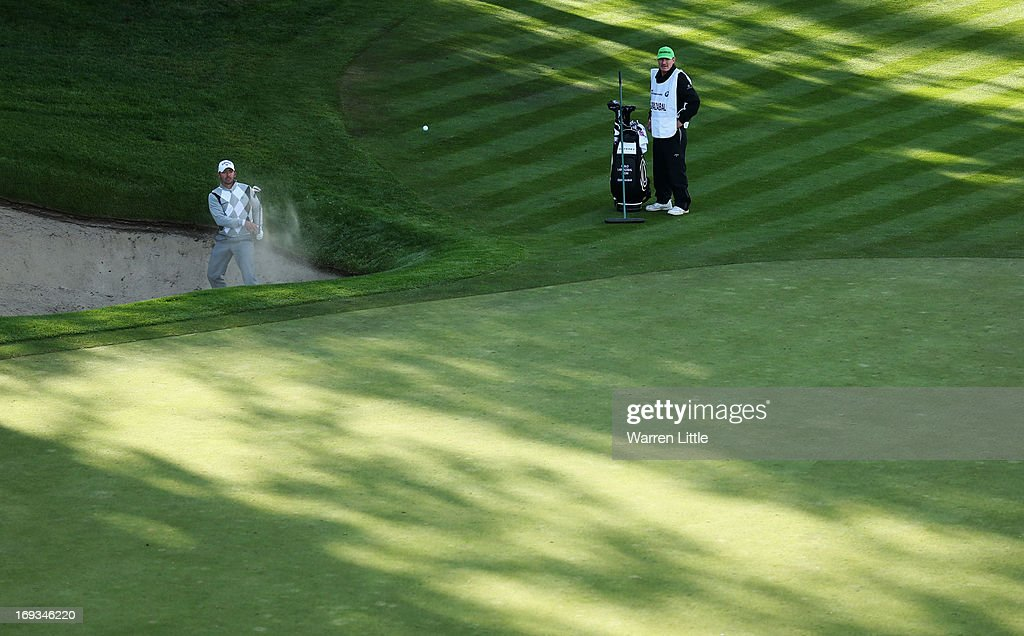 Pablo Larrazabal of Spain hits from a bunkwer on the 18th hole during the first round of the BMW PGA Championship on the West Course at Wentworth on May 23, 2013 in Virginia Water, England.