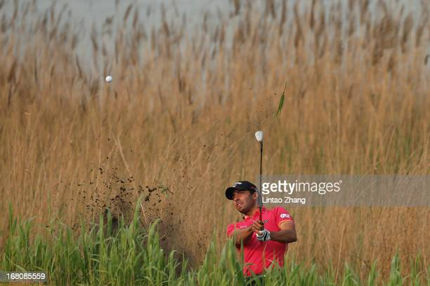 Pablo Larrazabal of Spain plays a shot during the during the final round of the Volvo China Open at Binhai Lake Golf Course on May 5, 2013 in...