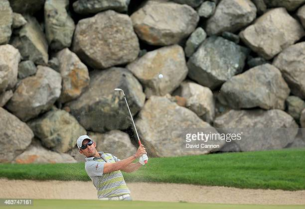 Pablo Larrazabal of Spain plays his second shot at the par 3 12th hole during the final round of the 2014 Abu Dhabi HSBC Golf Championship at Abu...