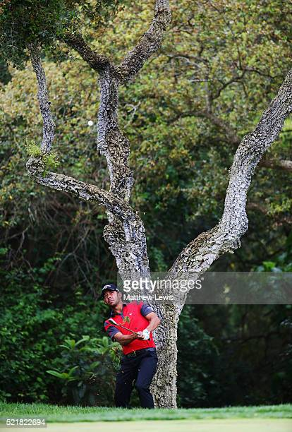 Pablo Larrazabal of Spain plays his second shot from the rough on the 12th hole during the final round on day four of the Open de Espana at Real Club...
