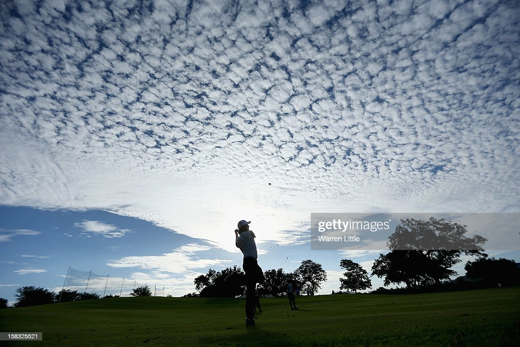 Pablo Larrazabal of Spain plays his second shot into the 18th green during the first round of the Alfred Dunhill Championship at Leopard Creek Country Golf Club on December 13, 2012 in Malelane, South Africa.
