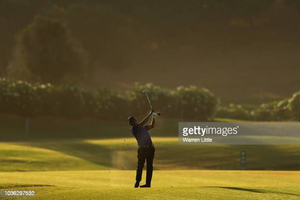 Danny Willett of England plays his second shot on the 18th hole during Day One of the Portugal Masters at Dom Pedro Victoria Golf Course on September...