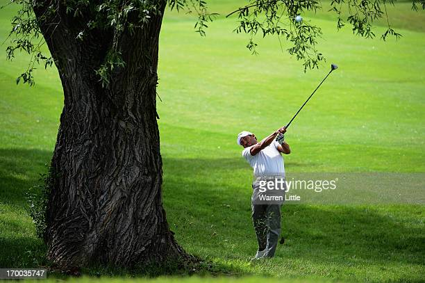 Pablo Larrazabal of Spain plays his second shot on the 13th hole from behind a tree during the first round of the Lyoness Open powered by Greenfinity...
