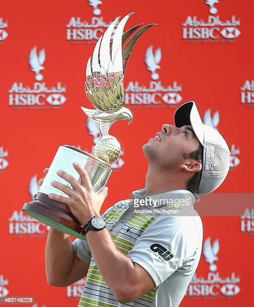 Pablo Larrazabal of Spain poses with the trophy after winning the Abu Dhabi HSBC Golf Championship at the Abu Dhabi Golf Cub on January 19 2014 in...