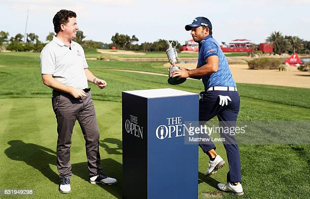 Pablo Larrazabal of Spain pretends to runoff with the Open trophy as Shane O'Donoghue looks on during the ProAm ahead of the Abu Dhabi HSBC...