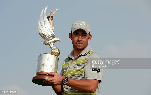 Pablo Larrazabal of Spain with the winners trophy after winning the tournament during the final round of the Abu Dhabi HSBC Golf Championship at the...