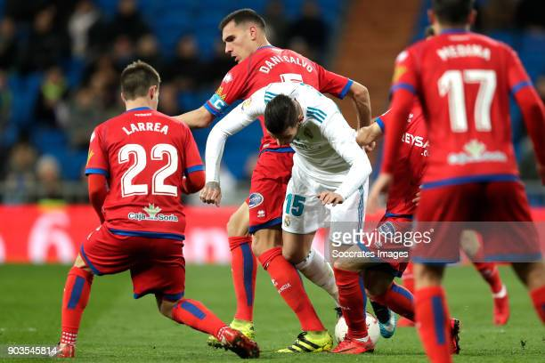 Pablo Larrea of Numancia Daniel Calvo of Numancia Theo Hernandez of Real Madrid during the Spanish Copa del Rey match between Real Madrid v Numancia...