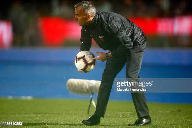 Pablo Lavallén head coach of Colon takes the ball during the final of Copa CONMEBOL Sudamericana 2019 between Colon and Independiente del Valle at...