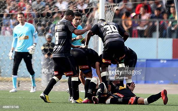 Pablo Lavandeira of UTC celebrates with his teammates after scoring the second goal of his team against Sporting Cristal during a match between UTC...